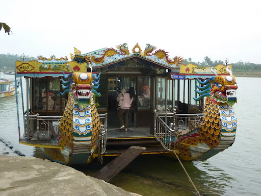 Next activity, a boat trip in Hue. Here is our fine dragon boat for the day, sweeping along the Perfume river striking dragon fear into all at shore...