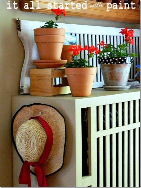 potting_bench_summer_mantel_straw_hat_geranium