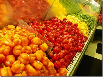 Peppers in various stages of ripeness:  orange, red, yellow, green.