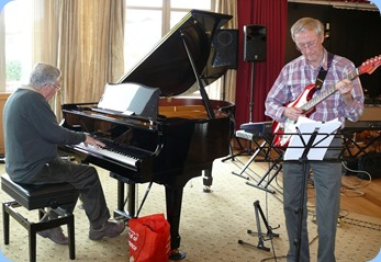 Jim Nicholson on grand piano and Brian Gunson on electric guitar. They were accompanying Len Hancy (vocals) and Peter Brophy (keyboard). Photo courtesy of Dennis Lyons.