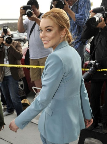 LOS ANGELES, CA - MARCH 29: Lindsay Lohan leaves court after her latest probation hearing at the Airport Courthouse on March 29, 2012 in Los Angeles, California.  Judge Stephanie Sautner ended Lohan's formal probation after concluding that she has completed the terms of her sentence for her 2007 DUI conviction and probation violations.  Lohan is now on informal probation until May 2014 for her 2011 Venice, California jewelry theft conviction.  (Photo by Toby Canham/Getty Images)