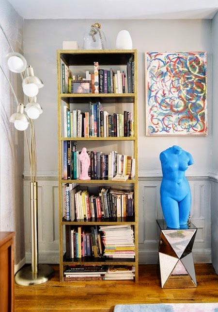 Wainscoting brass bookshelf beside blue bust bc9eVnJZbBal