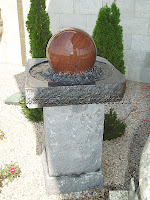 "Multicolor Granite Floating Sphere Fountain with Charcoal Grey Rock-face Pedestal.  Self-Contained. 30"" x 30"" x H56"" with 16"" Dia Ball."