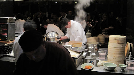 It took a lot of chefs to keep up with all the steaming baskets and frying pans.