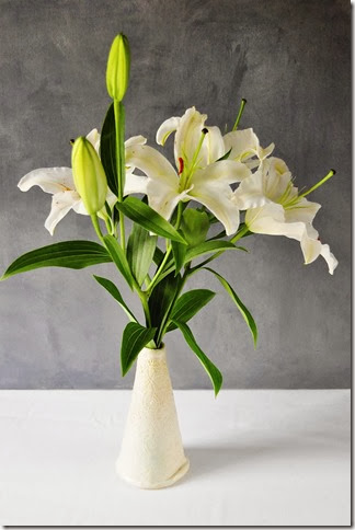 lilies in cone vase