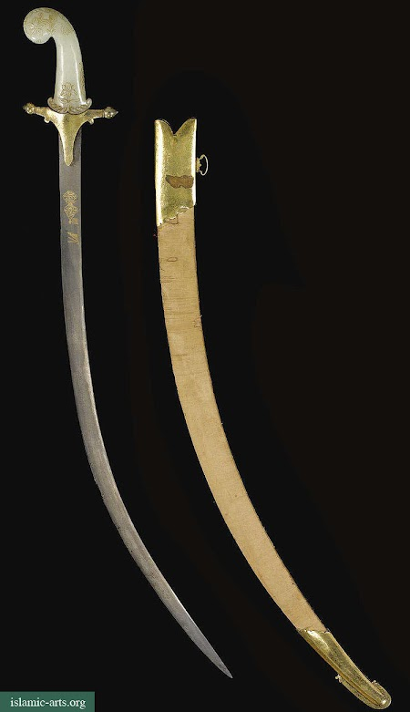 A MUGHAL JADE-HILTED SWORD WITH GILT-MOUNTED SCABBARD, INDIA