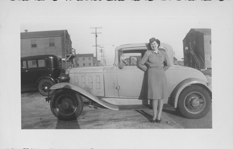 "Esther Herbert by a car in ""San Berdu"" (San Bernardino military base). Circa 1944."