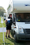 Andy the campsite manager instructs a French camper where to park