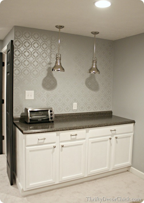 Basement kitchenette with stenciled wall