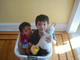 Eidan and Kai enjoying some juice in the laundry basket