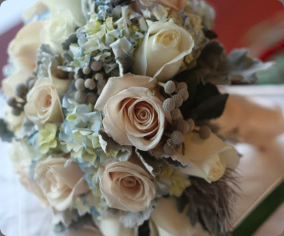 blue hydrangea, dusty miller, sahara roses, white roses, silver brunia, gray feathers and tiny crystals. holly chapple