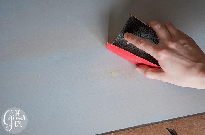 sand down wood filler