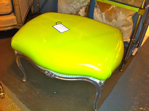 The combination of the bright patent material with the vintage frame of this stool is great.