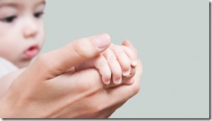 gty_mother_holds_babys_hand_ll_120110_wg