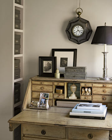 An antique Swedish desk occupies a front corner of the bedroom; its many drawers keep mail out of sight. The desktop displays some of Eric's favorite possessions.