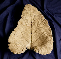 Unpainted elephant ear concrete leaf. I think I painted this one in pink and green.