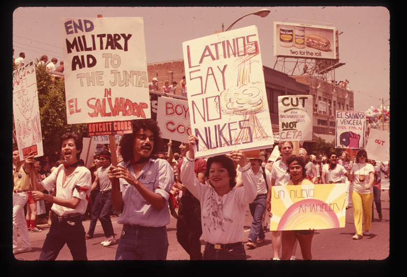 Latinos march in the Los Angeles Christopher Street West pride parade. 1982.