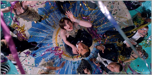 Jordan Baker (Elizabeth Debicki) and Nick Carraway (Tobey Maguire) living large at a party thrown by Jay Gatsby. CLICK to visit the official site for THE GREAT GATSBY movie.