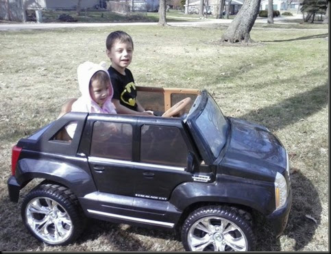 Aidan and Miranda in little car