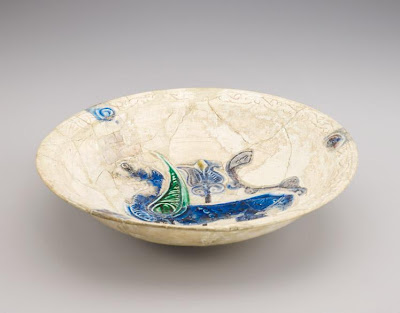 Deep bowl with winged griffon | Origin:  Iran | Period: 11th-12th century  Saljuq period | Details:  Not Available | Type: Stone-paste with carved decoration and colors in a transparent glaze | Size: H: 8.3  W: 34.4  cm | Museum Code: F1947.18 | Photograph and description taken from Freer and the Sackler (Smithsonian) Museums.