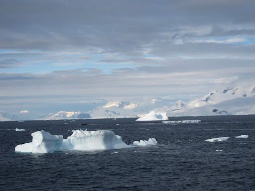 Icebergs dotting the water around latitude 66 degrees south.