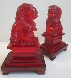 Pair of red Fu Dog acrylic resin sculptures