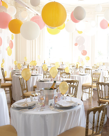 Let balloons rise to the occasion as a simple yet stylish way to fill a big space. The secret to a grown-up look? A simple color palette. Attach them to ribbons to make garlands for the ceiling.