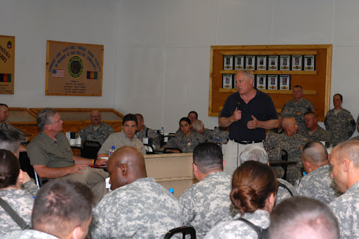 Gov. Jay Nixon (left) and Gov. Rick Perry, of Texas (center) listen as Gov. Patrick Quinn, of Illinois (right), expresses his appreciation to soldiers of Task Force Phoenix in Afghanistan on July 20. (photo courtesy: U.S. Department of Defense)
