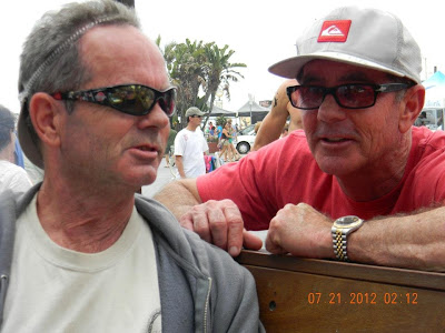 Bruce Logan (left) talking to his brother Brad at an event in Hermosa Bch. in 2012, looks like they are plotting something