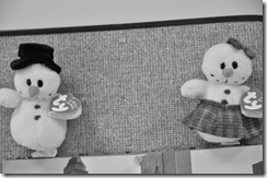 Mr. and Mrs. Snowman brighten up a bulletin board in the Business Office.