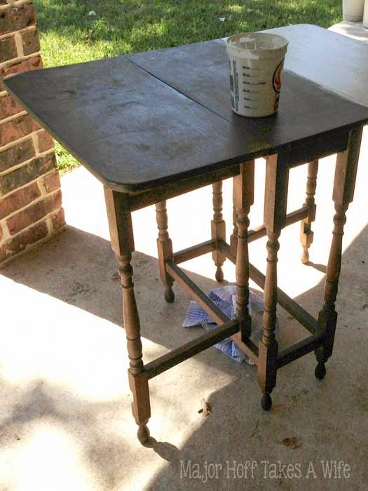 Gate leg table being painted