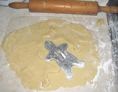 sugar cookie rolled out dough w gingbread cutter