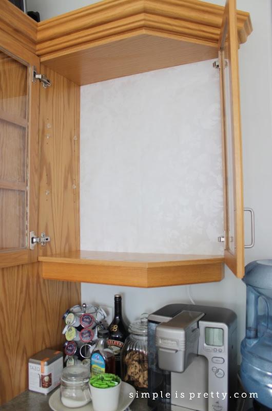 By Keurig during cabinet doors open