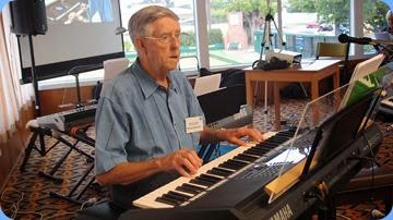 Michael Bramley playing his Yamaha PSR-S950 keyboard. Photo courtesy of Dennis Lyons