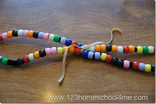 Now you have a large circle with 2 pipe cleaners and tie the center together with a rubberband
