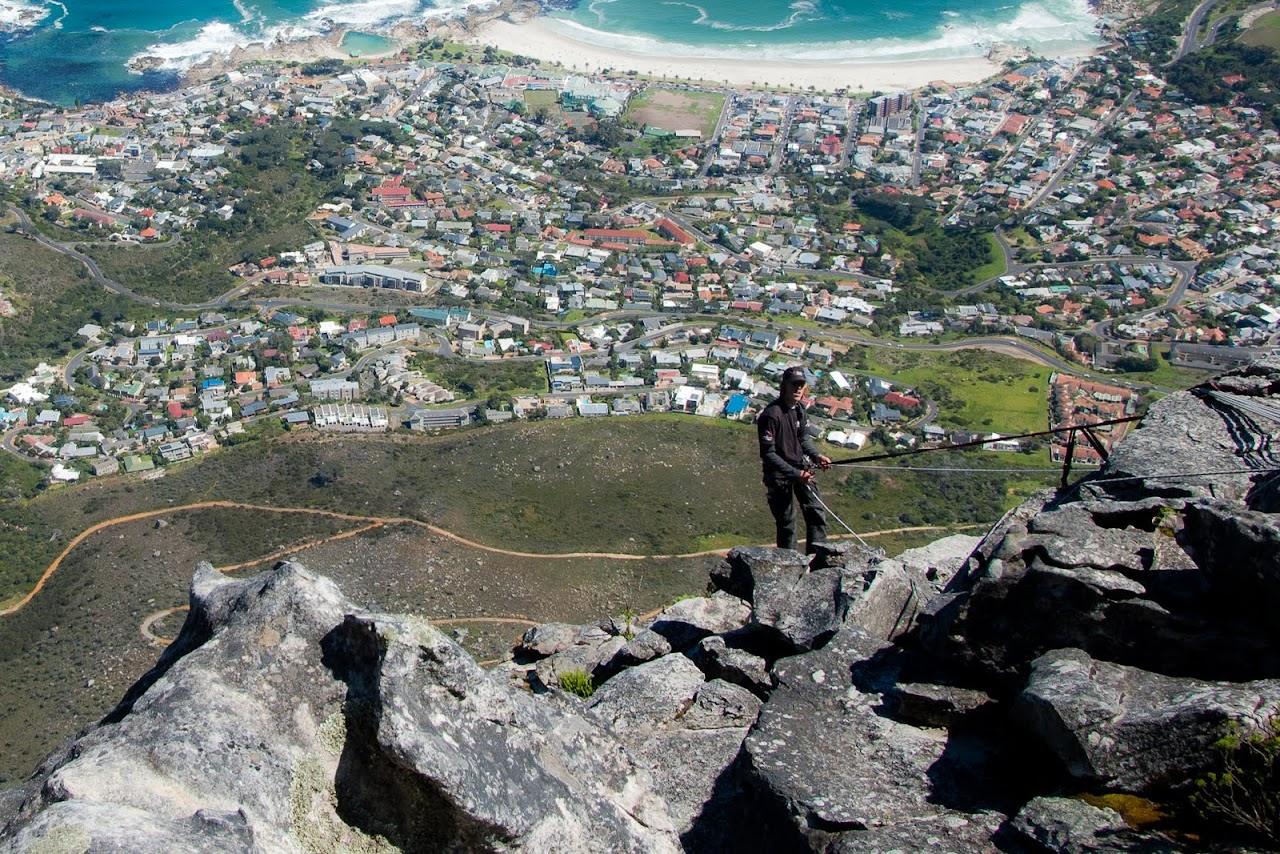 Hiker rappelling off Table Mountain