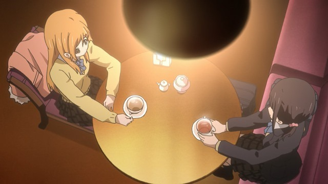 Kiriyama and Iori seen from above sitting across from each other at a cafe drinking tea bathed in orange light