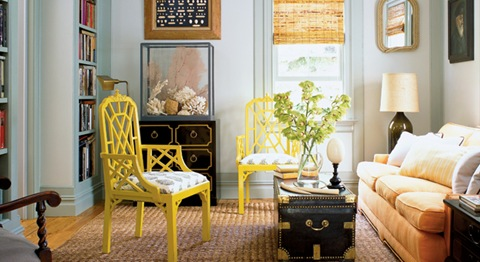 asian inspired living room with yellow chinese chippendale chairs