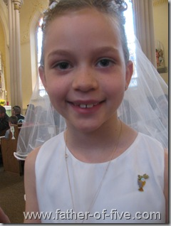 All smiles for #5 of 5 on her First Communion