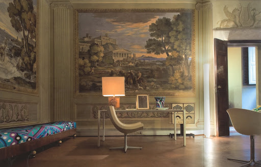 The combination of 19th Century frescoes and the bold silk empire banquette in the Odyssey Room of Palazzo Pucci, perfectly defines the man.