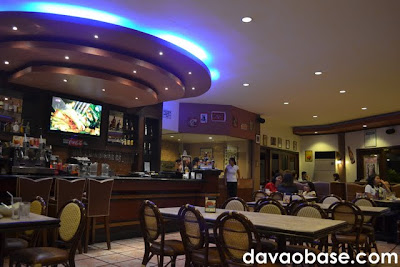 Inside Coco's South Bistro, with tables for families and a huge LCD TV