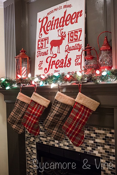 Plaid Country inpired Christmas Fireplace. A truly stunning Christmas Home Tour as part of the Christmas in the Country Blog Tour. This Plaid Inspired Country Christmas will knock your socks off. Features tours of the Living room, Dining Room and a Cocoa hot chocolate bar in the Breakfast room. There is so much inspiration for Christmas decorations in this one post. Be prepared to feel like you are cuddled up by the fire in a warm Northwoods comfy cottage! #country #Christmas #Plaid #Holiday decorating #Holiday ideas #Holidays #Christmas decor #Holiday decor
