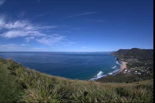 Stanwell park/beach and coastline taken with our new K7 with a borrowed Pentax DA10-17 fish-eye lens from Bald Hill lookout. Just need photoshop to get rid of the tripod shadow :P