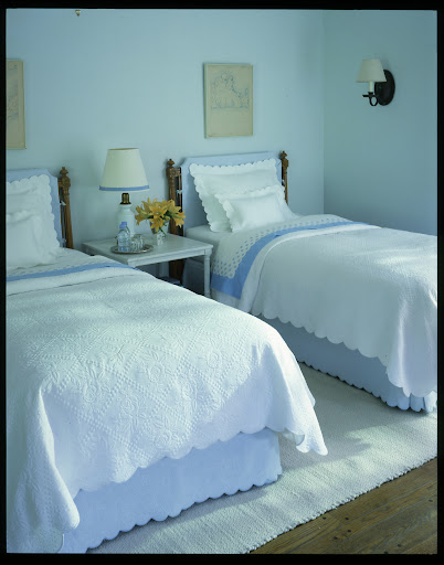 We updated these twin bed frames by covering the headboards in a soft color that matches the bedding.