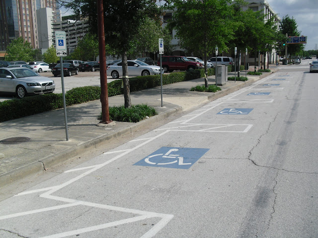 Thus  a person in a wheel chair can exit the car from the angled parking  space without having to travel either behind the car or go into the street. NewUrbanStreets   Parking Configurations for a Person with