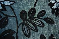 Tkanina obiciowa z efektem metalicznym w kwiaty. Czarna, grafitowa.