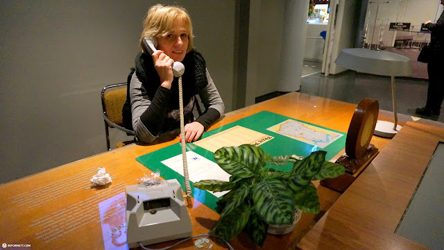 my mom making a call to Stalin at the DDR Museum in Berlin in Berlin, Berlin, Germany