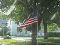Flag along Washington Street, placed by the Optimist Club of Washington.