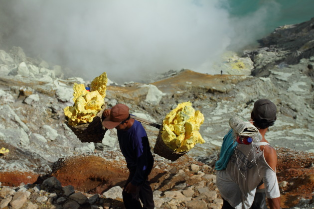 These sulphur miners carry more sulphur than their body weight