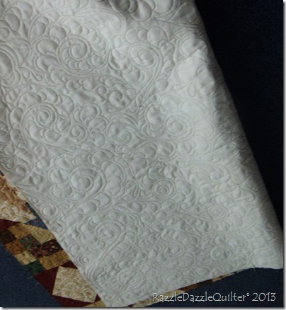 Machine quilted feathers